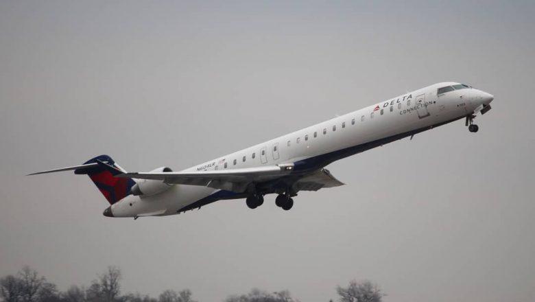 Bombardier CRJ-900LR  blasting off of runway